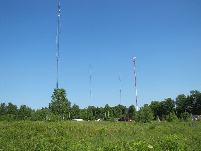 K1PQ Field Day operation was surrounded by commercial, government and amateur towers. The tower second from left belongs to PARC and is the home of N1BUG/R (147.105) and the new K1PQ/R (444.950). Photo Credit: KB1WEA